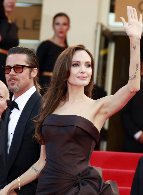 Angelina Jolie poses on the red carpet before the screening of The Tree of Life