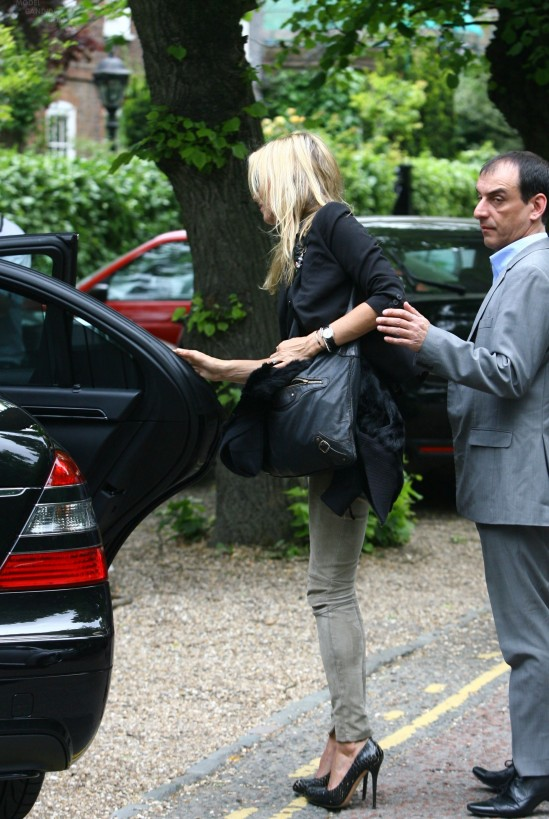 Kate Moss and fiancé Jamie Hince are seen leaving her home