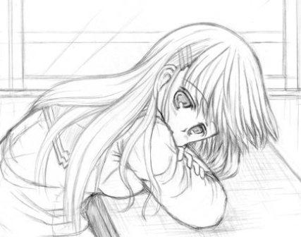 机で寝そべる女の子