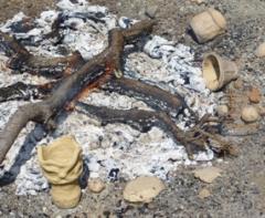 火の周りで乾かす