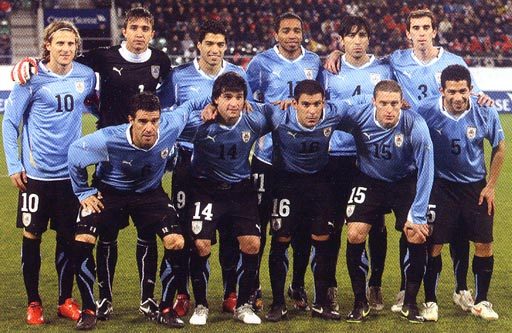 Uruguay-10-11-PUMA-kit-light20blue-black-black-pose.jpg