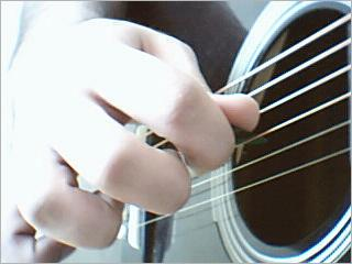 Playing_guitar_with_pick.jpg