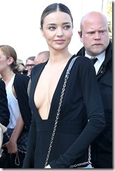 Miranda Kerr and Selena Gomez arriving at Louis Vuitton Show in Paris